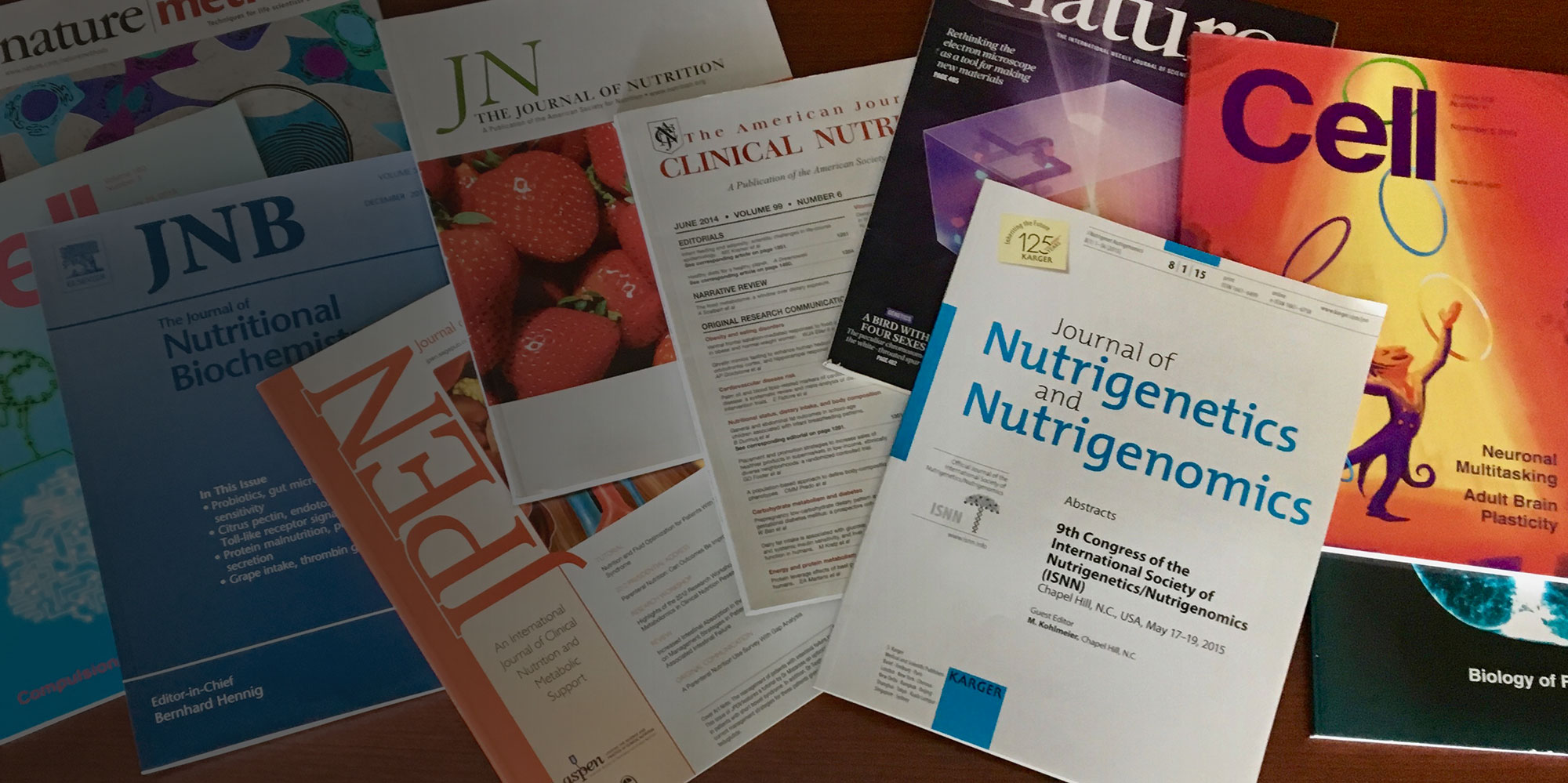 Various Nutritional Research Institute books are spread out.